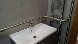 STAINLESS STEEL HANDRAILING ABOVE SINK AREA