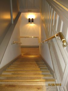 brass and stainless steel handrail